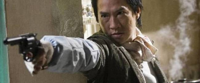 Wo (Nick Cheung) in the epic gun battle at the beginning of EXILED (2006)