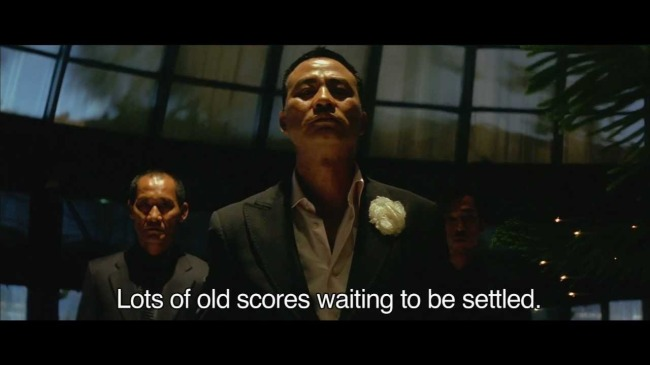 Hong Kong mega-superstar Simon Yam as Boss Fay in EXILED - image source: YouTube