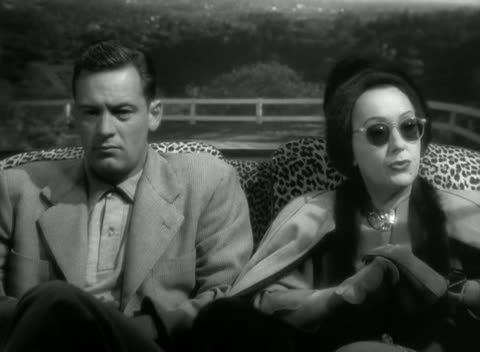 Joe and Norma in her vintage luxury automobile in SUNSET BOULEVARD (1950)