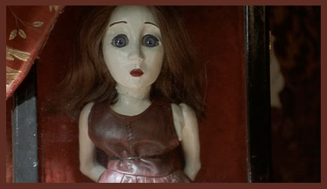 The doll in MAY (2002) - image source: bethanyannesblogs on WordPress