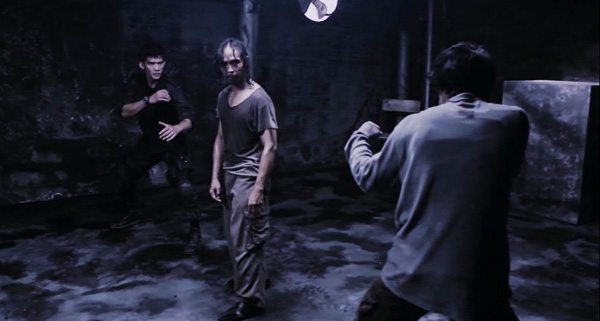 "Yayan Ruhian (center) as Mad Dog in ""The Raid: Redemption"""