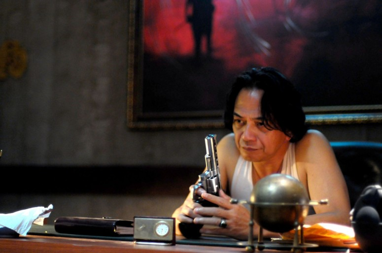 "Veteran actor Ray Sahetapy as boss Tama in ""The Raid: Redemption"""
