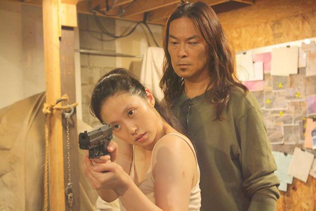 Mayumi/Gun Woman (Asami) and Mastermind (Narita) in GUN WOMAN (2014)