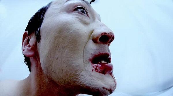 Kamata as Hamazaki's Son in GUN WOMAN (2014)