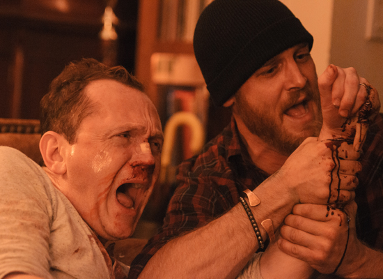 Pat Healy as Craig and Ethan Embry as Vince in CHEAP THRILLS (2013)